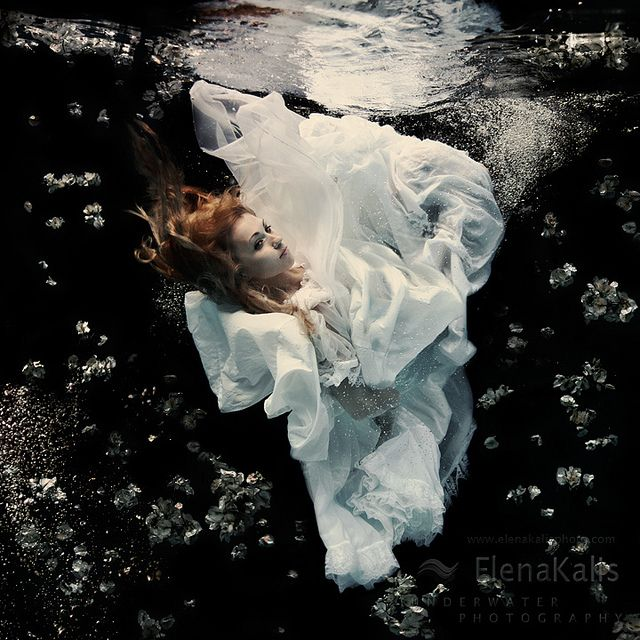 """Beautiful underwater photography by Elena Kalis. In her """"Alice In Waterland"""" series, she used her own daughter Sascha as a model....."""