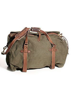Filson bag. this is my favorite bag! it is 100% durable, the perfect size, and always looks perfect! best travel bag ever.