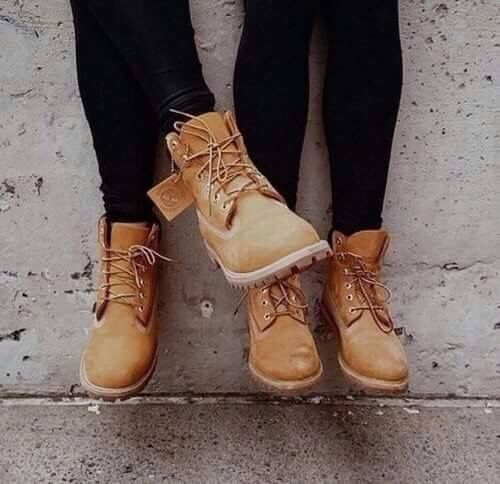 Matching brown timberland boots for mom and daughter.