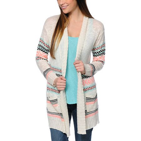 For a lightweight layer with a pop of color throw on the Empyre Girl Basmati Cream and Tribal Print cardigan sweater. The multicolor tribal design pops against the loose knit Cream fabric, while the slouchy fit with open front of this Empyre cardigan swea