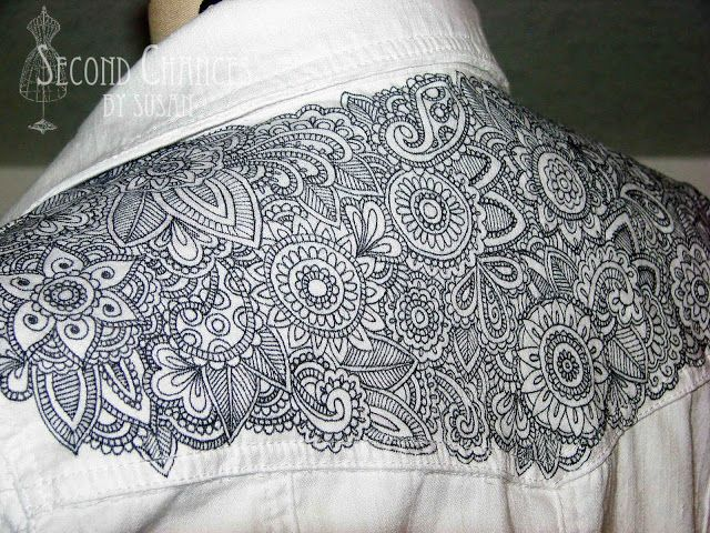 "The ""Tattooed"" Denim Jacket Tutorial shows you how to ""tattoo"" a denim jacket using a sharpie marker, glue, and fabric dye."
