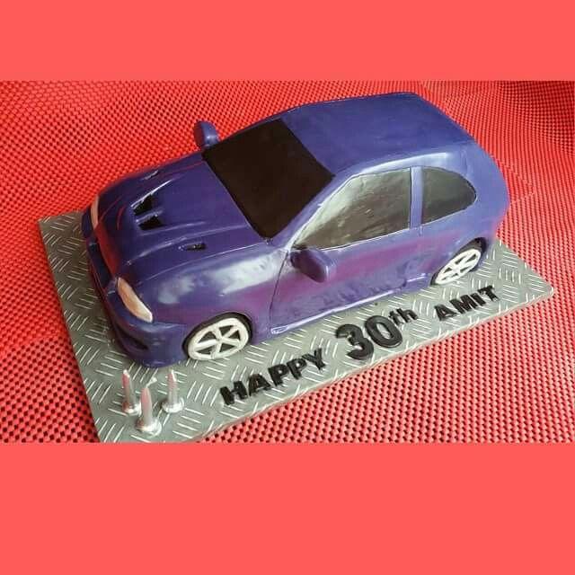 Chocolate cake with nutella ganache Mitsubishi mirage.  #cake #cupcakes #cakeart #car #carcake #birthdaycake