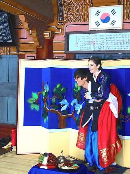 Korean Wedding Ceremony: A traditional paebaek ceremony only for family members includes a piggy back ride in the traditional Korean ceremony.