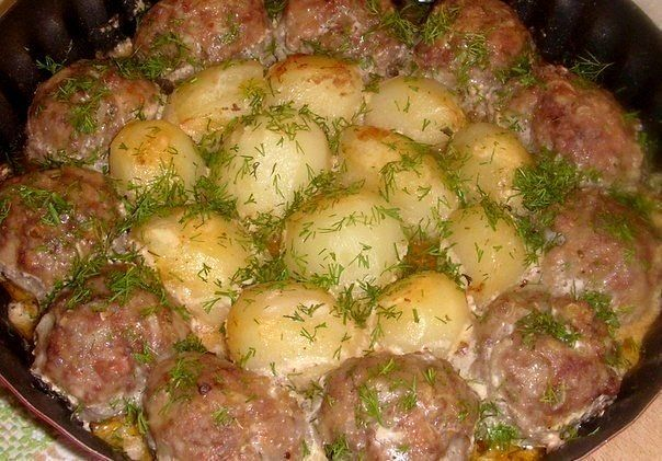 Meatballs with potatoes in a creamy tomato sauce