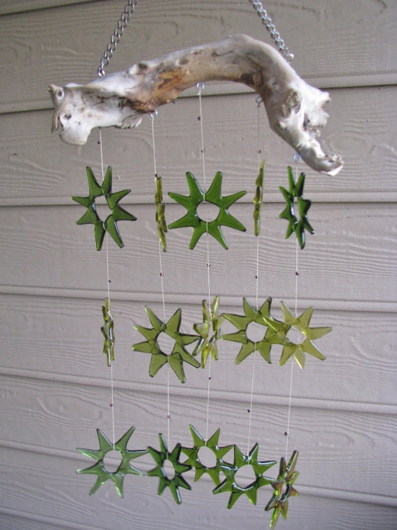 The bottles are collected from the dump, cleaned, cut into stripes and into triangles. Laid into star shapes and ut into the kiln to fuse the glass. Each star is hand tied to the piece of driftwood from a lake in the Pacific Northwest. This wind chime is for indoor use only. The gorgeous sound of it tinkling as you walk by is amazing.