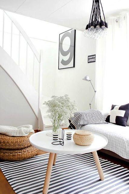 Mooi voorbeeld van een woonkamer in #zwart en #wit met veel sfeer