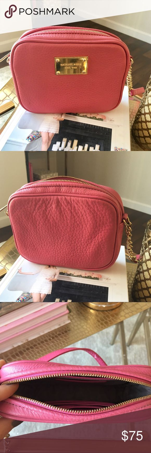 Pink Micheal Kors Jet Set Crossbody Bag Adorable bag with classic MK gold hardware and chain extension to support strap. In great condition, used no more than just a few times. Interior is like new as well, featuring zip pocket and 4 card slots. Not getting any love in my closet, ready for a new home! Michael Kors Bags Crossbody Bags