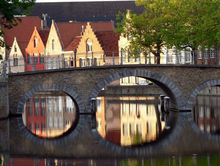 Bridge over the Potterierei (canal), Bruges, Belgium. Photo: Brugge @ Panoramio. Beautiful reflection effect!