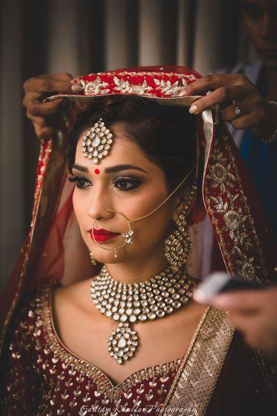 Indian Wedding Jewelry - Polki Wedding Jewelry with Red Veil and Lehenga.