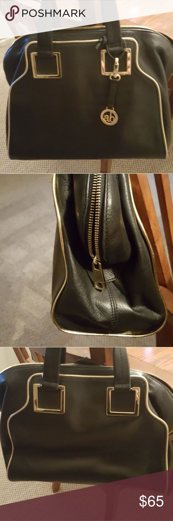 Audrey Brooke bowling bag Black with gold trim leather bowling bag NEW. Perfect condition. Lots of room inside. 2 zipper pockets indide. Audrey Brooke Bags Satchels
