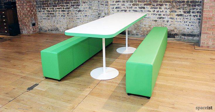Lime green long soft bench.