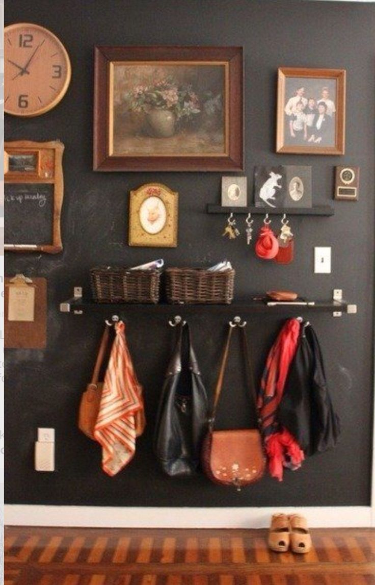 """Wall shelf, hooks, baskets and cup hooks make for a great """"entry"""" by front door."""