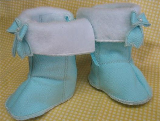 Easy Baby Boots embroidery in the hoop lace up the back. bow design included. Site has many more designs for baby shoes in hoop.