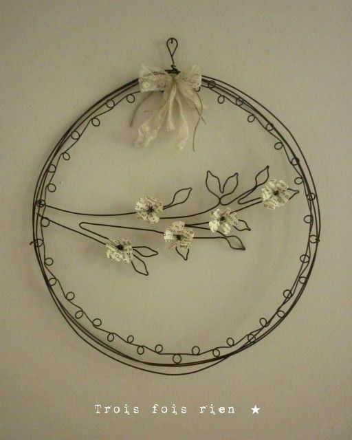 wire wreath with a budding branch - love this - simple - black & cream