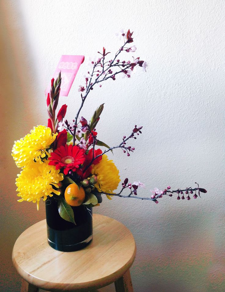 Golden chrysanthemums, red gerbera, gladioli and miniature citrus - lots of red and gold round forms for maximum luck and fortune!