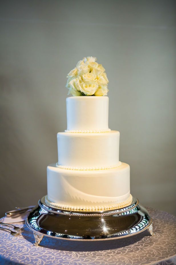 Classic three tier wedding cake with rose floral cake topper (Photo by jeannemarie photography)
