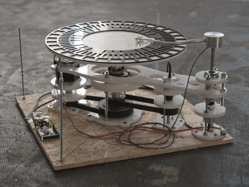 http://www.kuji.kjundersound.com/soundmachines-optical-turntable/    Three units, which are resembling standard record players, translate concentric visual patterns into control signals for further processing in any music software.