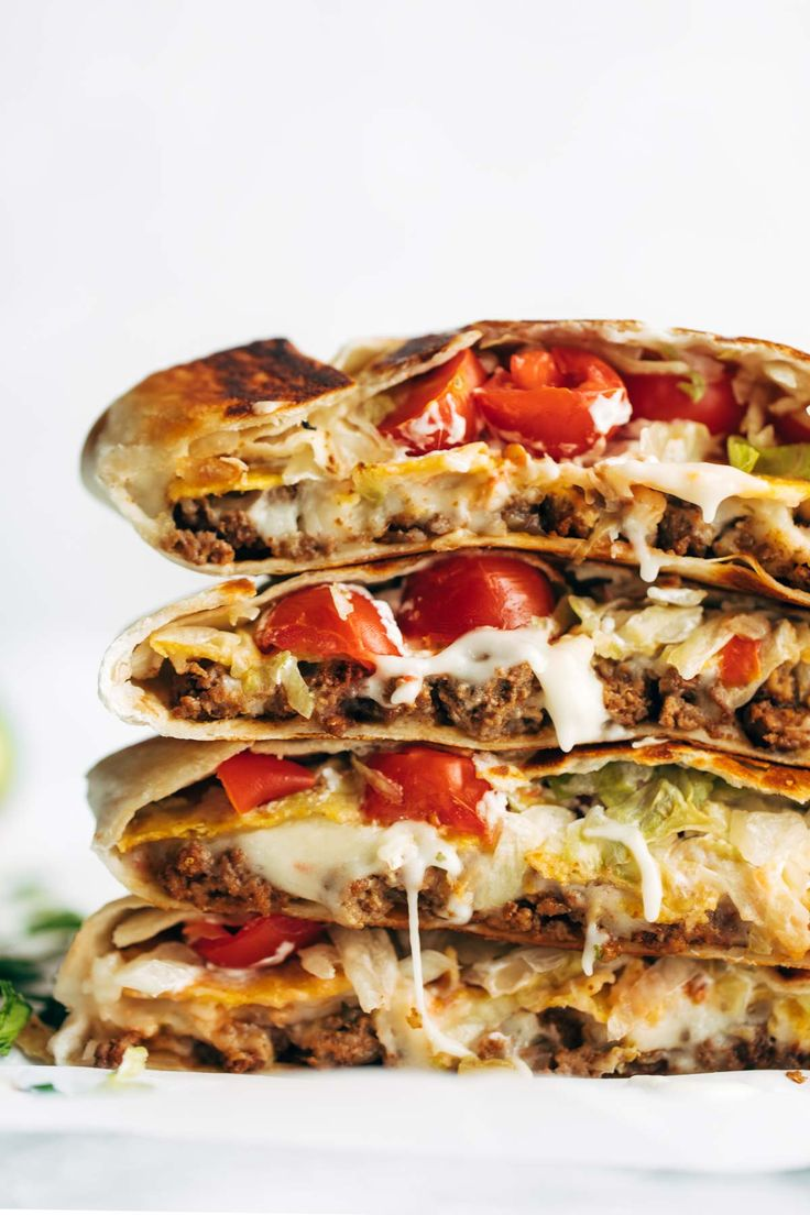 Crunchwrap Supreme! OMG. Layers of taco meat, queso, tostada, lettuce, tomato, salsa, hot sauce, and sour cream.
