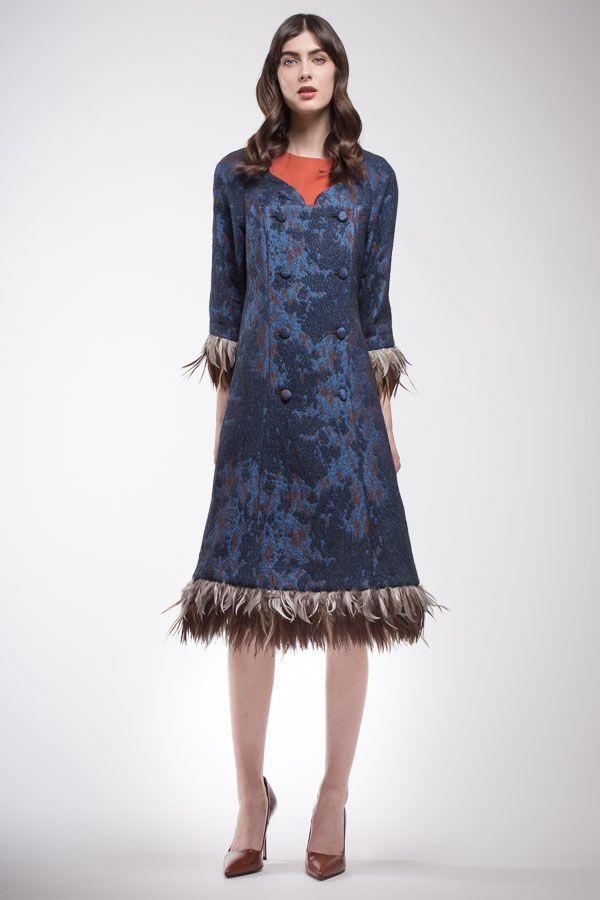 Blue and brown jacquard operated dress with feathers on the brink