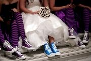 Sometimes, the easiest way to bring a theme together is to jump in feet first... with your shoes! LMAC Photography non-traditional wedding bright blue bride converse and purple bridesmaids' converse | As seen on TodaysBride.com