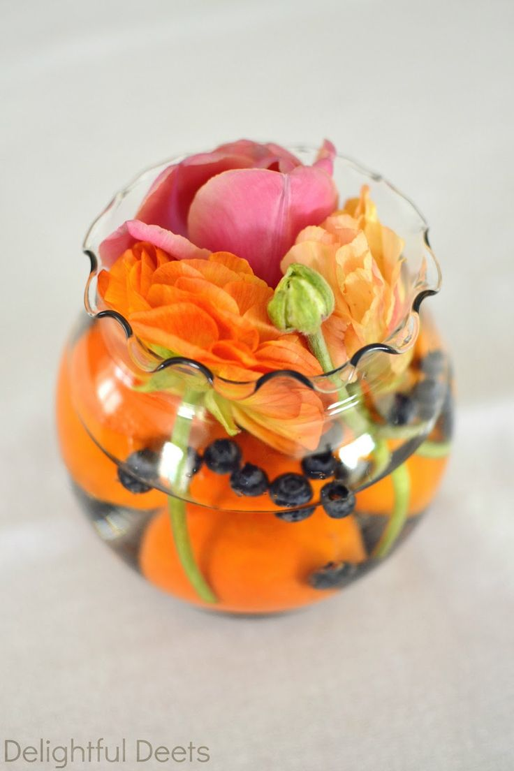 Delightful Deets: Navy & Coral Baby Shower for Summer LOVE these party centerpieces-fresh flowers and fruit in a few little bowls from Michaels (flowers, clementines and blueberries)