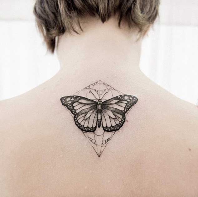 Butterfly Tattoo on Back by Uls Metzger