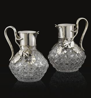 A PAIR OF SILVER-MOUNTED GLASS JUGS MARKED K. FABERGÉ WITH THE IMPERIAL WARRANT, MOSCOW, CIRCA 1890