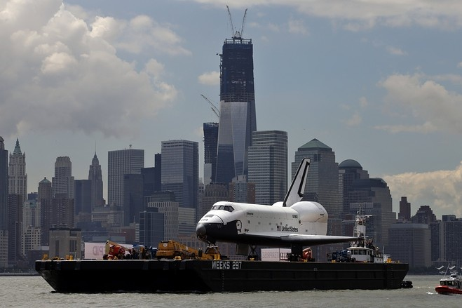 Space Shuttle Enterprise floated along the Hudson River on the final leg of its journey to become a Manhattan museum piece.   Intrepid Sea, Air & Space Museum. Here atop a barge, it passes lower Manhattan and the still under construction 1 World Trade Center Tower. Reuters, WSJ.com