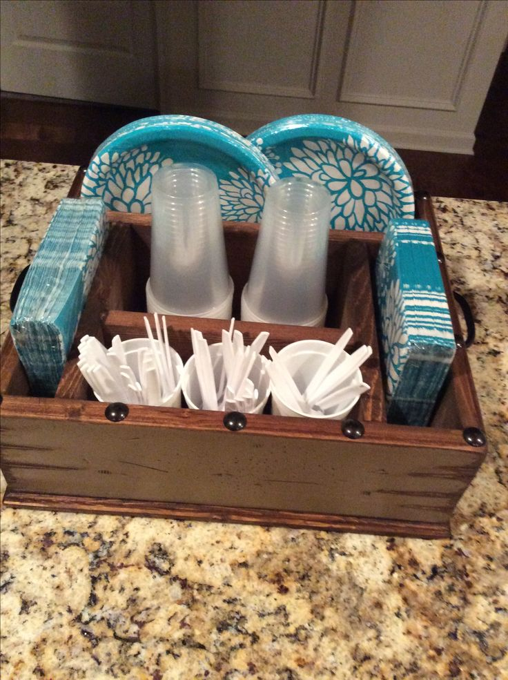 Table Caddy. Purchased on Etsy.com. I use this to organize all my picnic supplies. Buy three glass cheese shakers from the Dollar Store to store your utensils. Fits like a glove!
