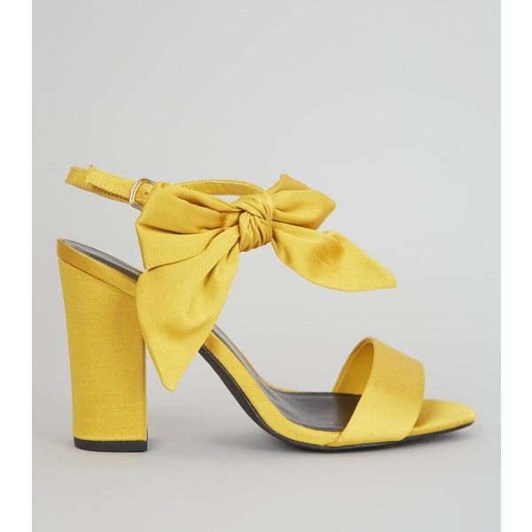 New Look Yellow Satin Bow Side Heeled Sandals ($39) ❤ liked on Polyvore featuring shoes, sandals, yellow, strappy high heel sandals, strappy sandals, bow sandals, block heel sandals and yellow heeled sandals
