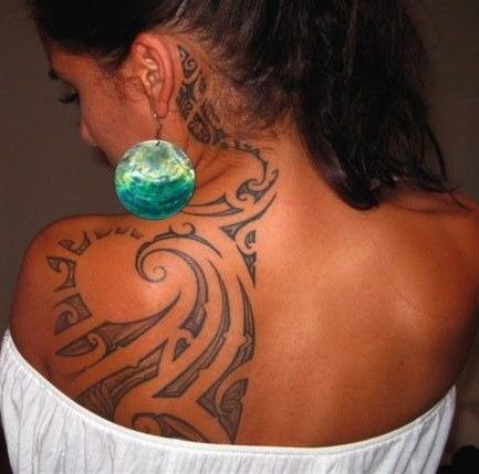hawaiian tribal wave tattoos for women | girl s half back tattoo this girl s back tribal tattoo is very ...