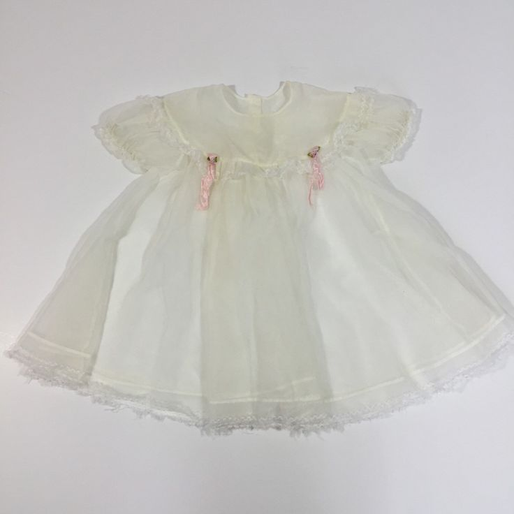 A personal favorite from my Etsy shop https://www.etsy.com/listing/293404671/vintage-sheer-baby-dress-12-months-18