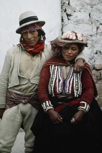 A couple wears their traditional wool garments on market day.---Aw...college…