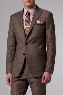 Dark brown suits look nice with a lighter reddish contrast. Bold patterns on ties also noted.