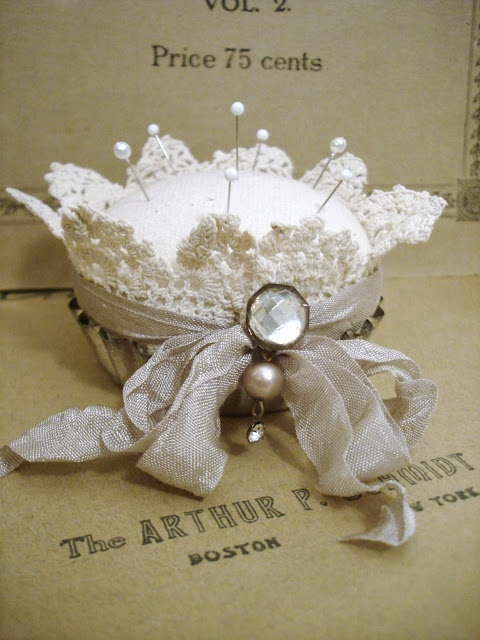 ~ The Feathered Nest ~has this cute little pincushion in a tart pan and some 'fancies' to decorate it. I think I'll have to try something like this.