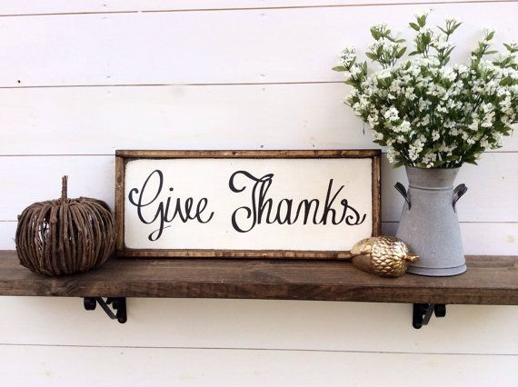 Give Thanks Wood Sign Fall Sign Autumn Sign Thanksgiving Sign It is 10 1/2 x 26 with its frame which is stained a dark walnut It hangs from a framed ledge on the back so no hanging hardware is needed It is white with black letters Our signs are rustic, hand painted and distressed so again there will be imperfections and no 2 will be alike