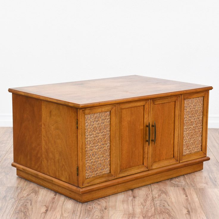 This retro end table is featured in a solid wood with a light maple finish. This side table is in great condition with 2 folding doors, a large interior cabinet space and woven geometric door inlays. Perfect as a small record cabinet with plenty of storage! #retro #tables #endtable #sandiegovintage #vintagefurniture