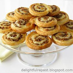 Sausage Pinwheels    1/2 pound bulk sausage, cooked and cooled  1 sheet (1/2 package) frozen puff pastry  1/4 cup finely shredded Parmesan  1 large egg  1 tablespoon water