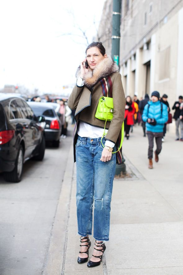 What I love about her look..Fur- Check!...Neon-Check!...Asymmetrical Hem- Check!...Boyfriend Jeans-Check!  Love it!