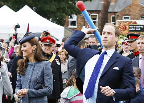 Prince William launches a nerf rocket and lands it five feet past Kate's best attempt!