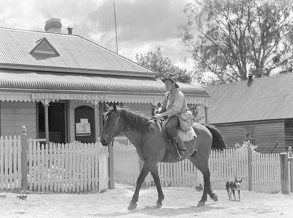 A Postman on horse back outside the Nelligen Post Office, New South Wales. Learn more about Australia Post's history here: http://auspo.st/1C0gYkJ