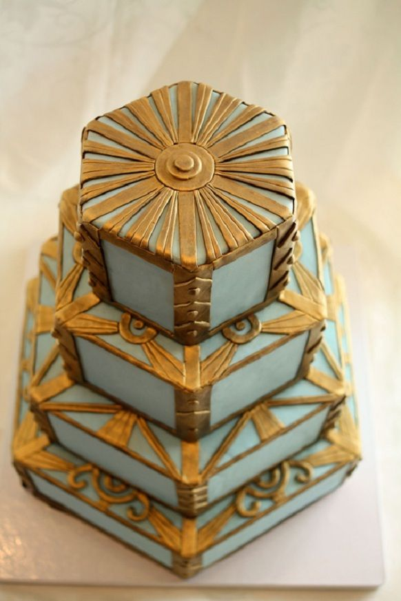 Renaissance-Style Wedding Cake    Go for the bold, gold and blue with a stand-out cake designed to conquer guests in a legendary way.  Play up the Roman association or surround it with pretty pinks and pastels for a classic French feel!