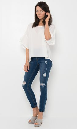 EM677B James Jean by ELLY M has a mid-high rise waist with a zip and button fly with front and back pockets. These women's jeans feature a flattering skinny leg fit and ankle length finish with distressed detailing. Comes in blue. Wear these effortlessly stylish jeans with a white betty basic t-shirt and sneakers for a cool casual look or with some heels and cropped blouse for a stylish weekend outfit.