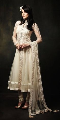 The perfect white anarkali. The flower in the hair looks lovely, too.