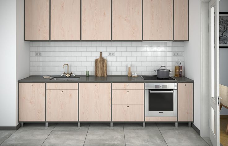 Modern kitchen fronts in mdf with frames in dark grey. Looking great in a scandinavian style kitchen!
