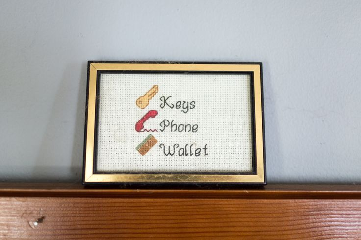 This cross stitch was made by a friend of the couple, and sits above the entryway mirror... Always a good reminder.
