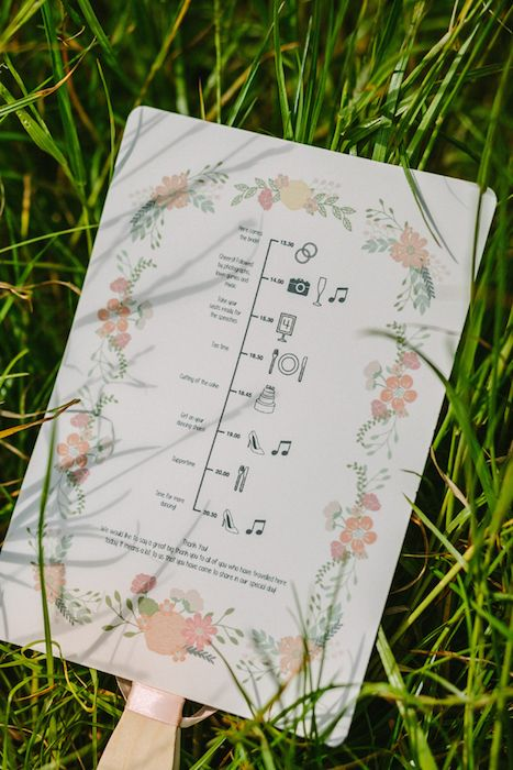 Floral timeline wedding program (via Intimate Weddings).