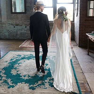 Erika Garcy walked down the aisle in our silky open-back Lucinda dress and Tatia veil.