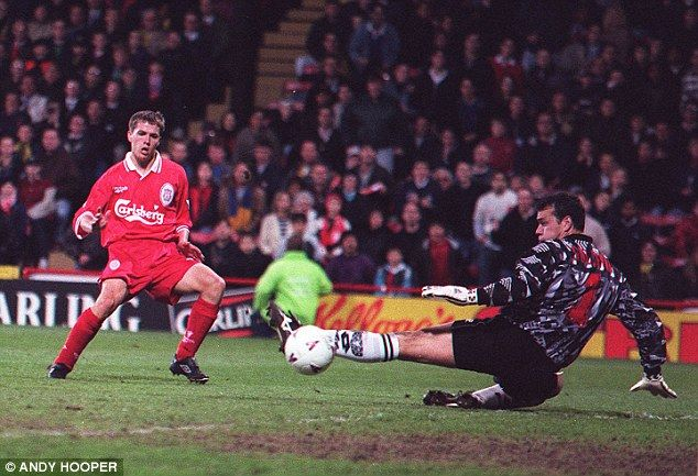 Michael Owen slots pastNeil Sullivan to become Liverpool's youngest-ever scorer in 1997