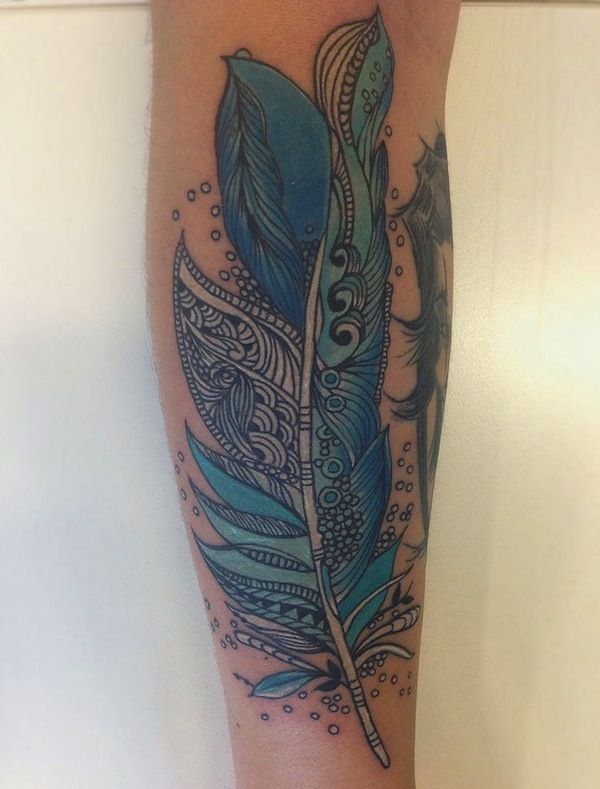 Blue feather tattoo, don't stop in one color, feather tattoo looks great in different colors too.  #TattooModels #tattoo